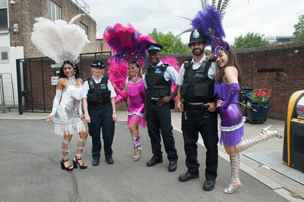 2017 Waterloo Carnival with dancers from London School of Samba and local police posing together