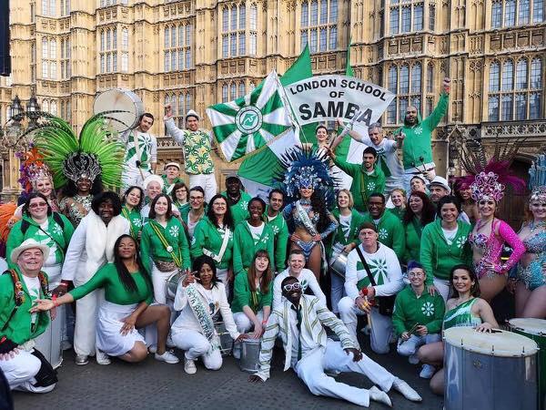 London School of Samba - photo of the drummers and dancers at a London Samba Gig